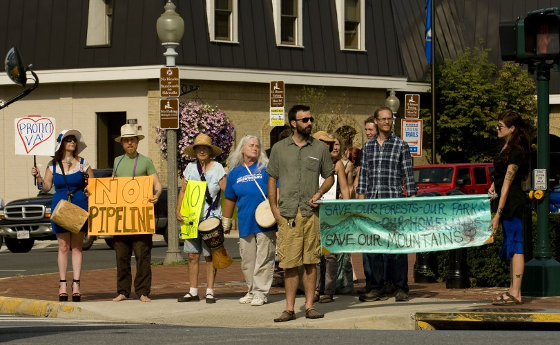 Members of the Women's Alliance of Environmental Justice and Renewal march along the corner of Main Street and Royal Avenue in Front Royal on Tuesday evening to protest hydraulic fracking and gas pipeline construction. Rich Cooley/Daily